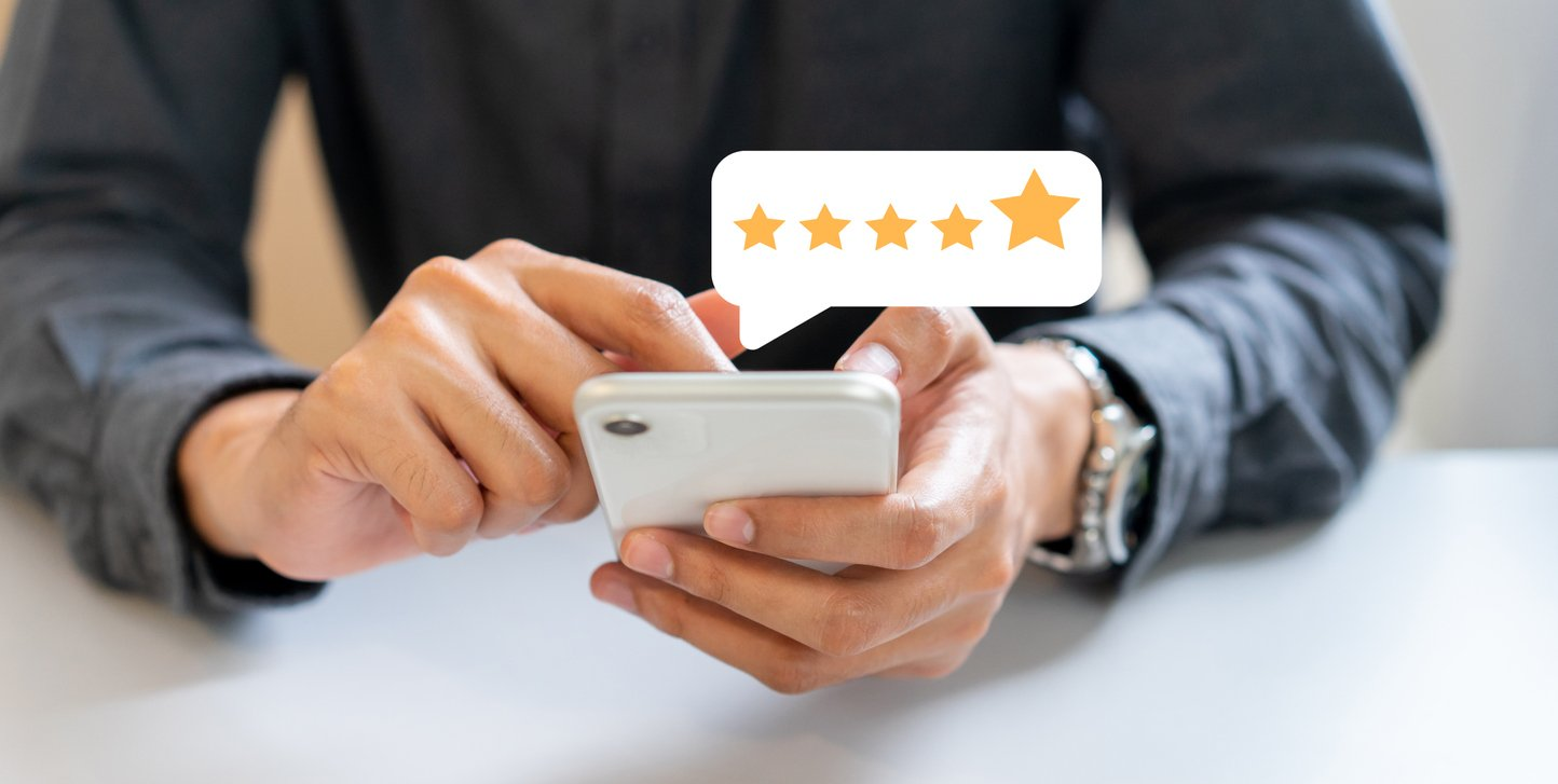 close-up-on-businessman-hand-pressing-on-smartphone-screen-with-gold-five-star-rating-feedback-icon-and-press-level-excellent-rank-for-giving-best-score-point-to-review-the-service-,-technology-1190357414_1446x728